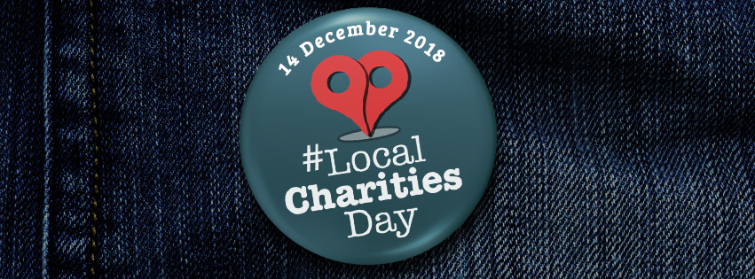 local charities day logo on badge, attached to denim jacket
